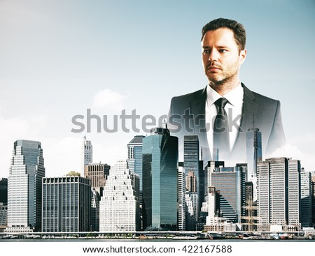 Thoughtful businessman in city - stock photo