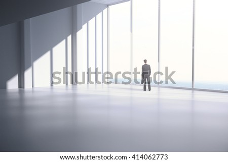 Thoughtful businessman looking out the window in empty interior. 3D Rendering