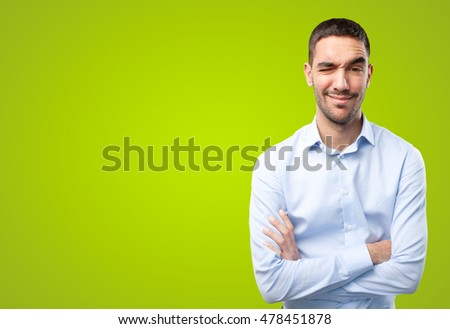 Thoughtful businessman on green background