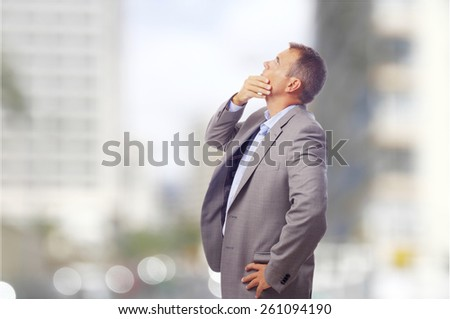 thoughtful businessman on the street - stock photo