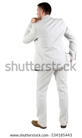 thoughtful businessman. Rear view. isolated over white