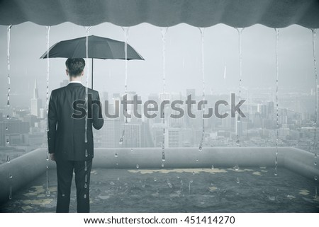 Thoughtful businessman with umbrella standing in the rain dripping from roof. Research concept