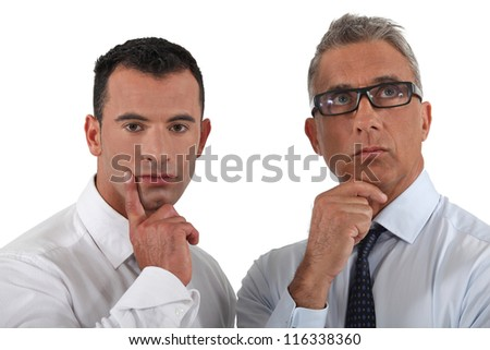 Thoughtful businessmen - stock photo