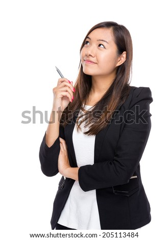 Thoughtful businesswoman looking up - stock photo