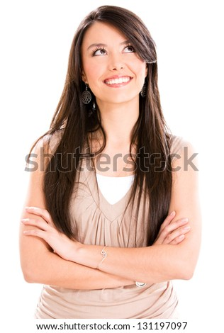 Thoughtful casual woman looking up - isolated over a white background