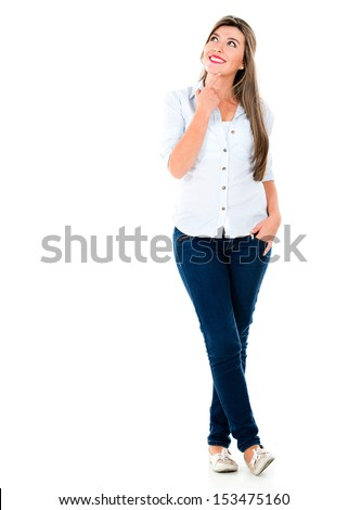 Thoughtful casual woman looking up - isolated over white background - stock photo