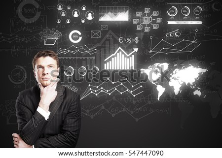 Thoughtful caucasian businessman on dark background with digital charts. Business concept