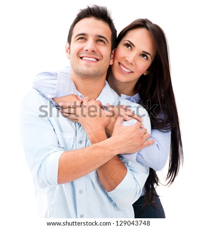 Thoughtful couple hugging and looking up - isolated over white - stock photo