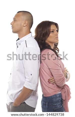 Thoughtful Couple Standing Back To Back Over White Background - stock photo