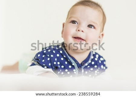 Thoughtful Curious and Smiling Caucasian Newborn LIttle Girl. Horizontal Image Composition - stock photo