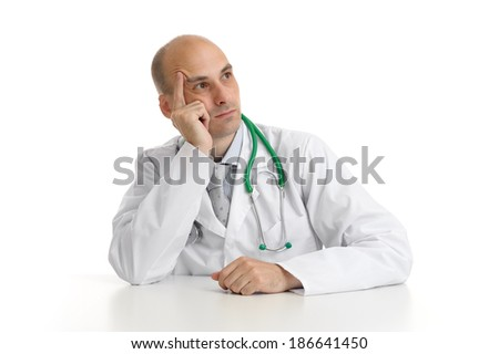thoughtful doctor isolated on white background