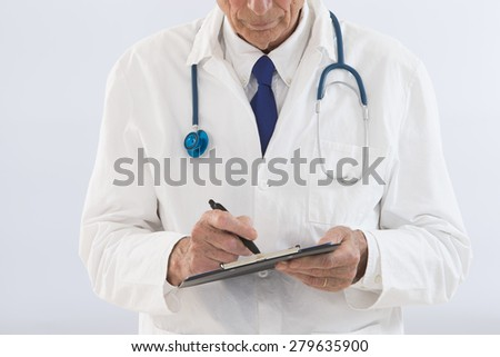 thoughtful doctor whiting on clipboard - stock photo