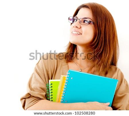 Thoughtful female student holding notebooks - isolated over a white background - stock photo