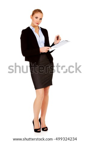 Thoughtful focused business woman holding clipboard