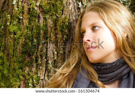 Thoughtful girl in nature - stock photo