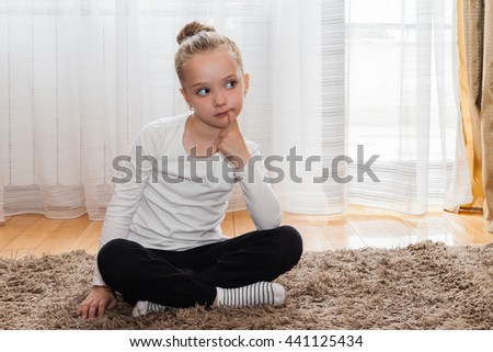 Thoughtful girl sitting in a yoga position