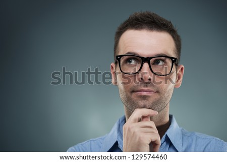 Thoughtful handsome male - stock photo