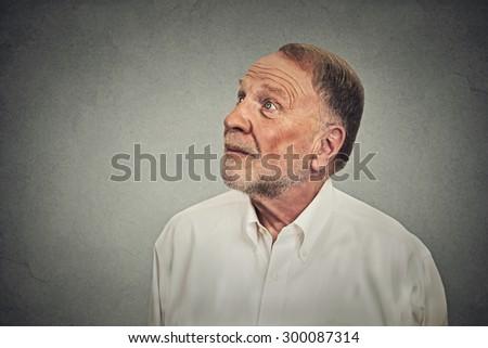 Thoughtful happy senior man  - stock photo