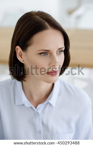 Thoughtful lady making serious decision - stock photo