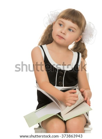 Thoughtful little blonde girl with short bangs and long pigtails braided in are large white bows , reading a book. Closeup - Isolated on white background
