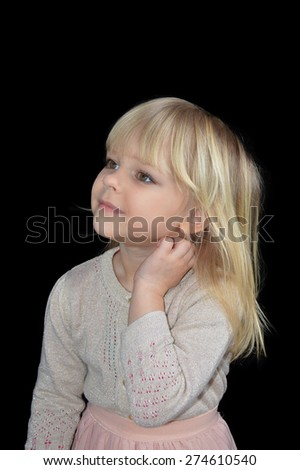 Thoughtful little girl on a black background - stock photo