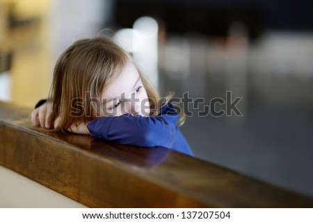 Thoughtful little girl portrait indoors - stock photo