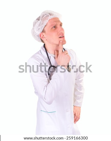 Thoughtful male doctor looking away while standing against, isolated on white - stock photo