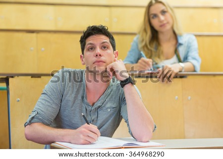 Thoughtful male student during class at the lecture hall
