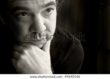 Thoughtful man. Black and white portrait