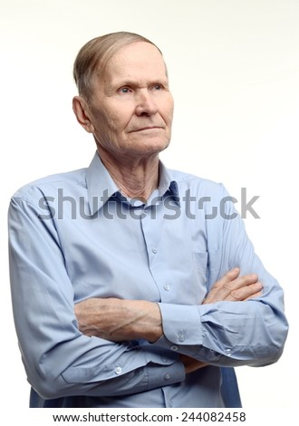 Thoughtful man, hands crossed on chest  - stock photo