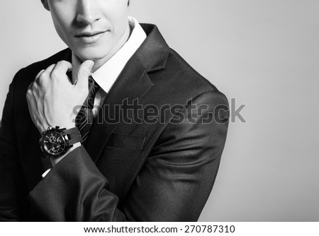 Thoughtful man in suit wearing watch.  - stock photo