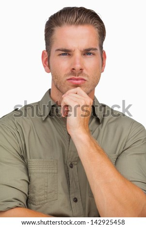 Thoughtful man looking at camera on white background