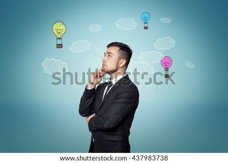 Thoughtful man on blue background with hand-drawn bulb-parachutes and clouds. Business concept. Good idea is the way to wealth and success. Formation of ideas. Decision-making. Business idea. - stock photo
