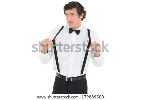 Thoughtful man stretching suspenders isolated over white background - stock photo