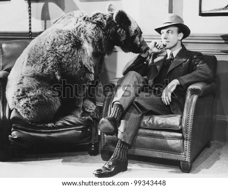 Thoughtful man with bear - stock photo