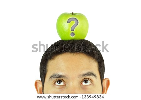 Thoughtful man with green apple & question mark over his head - stock photo
