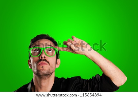 thoughtful man with green eyeglasses and green background