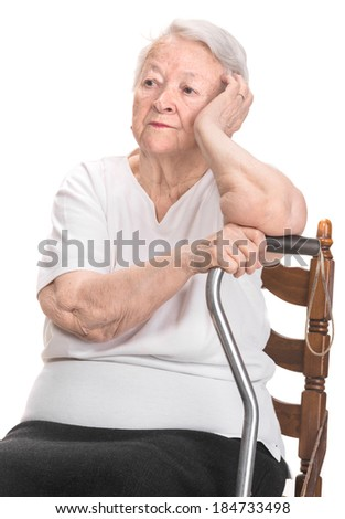 Thoughtful old woman on a white background - stock photo