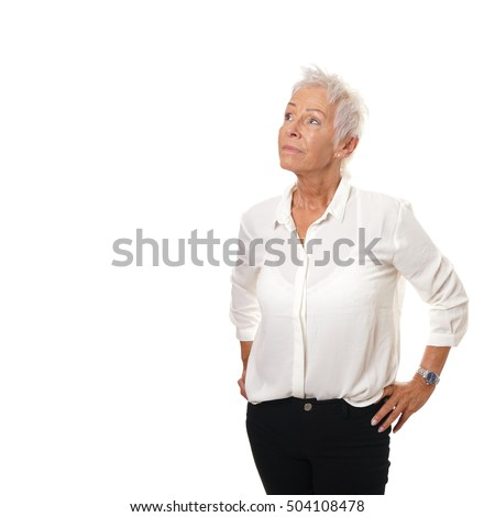 thoughtful older woman looking up at copy space
