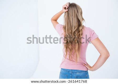 Thoughtful pretty woman on white background - stock photo