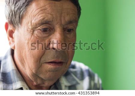 Thoughtful senior looking away  - stock photo