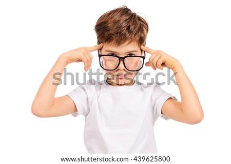 Thoughtful smart boy wearing big glasses. Education. Optics. Studio shot. Isolated over white. - stock photo