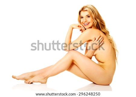 Thoughtful spa young woman sitting. - stock photo
