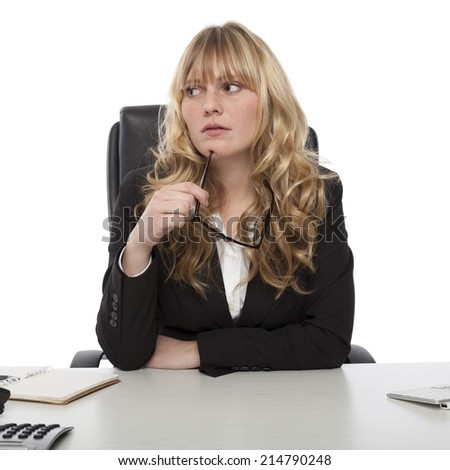 Thoughtful stylish young business manageress sitting staring pensively off to the side with her glasses in her hand, on white - stock photo