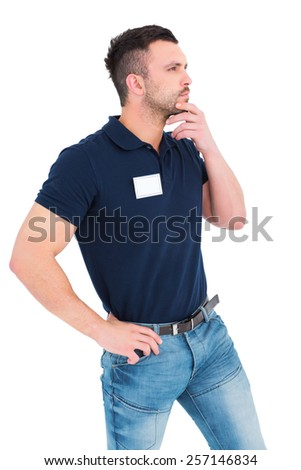 Thoughtful technician with hand on chin over white background