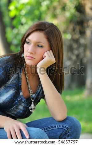 Thoughtful teen girl - stock photo