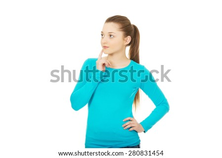Thoughtful teenage woman looking up. - stock photo
