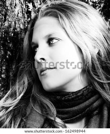 Thoughtful woman - stock photo