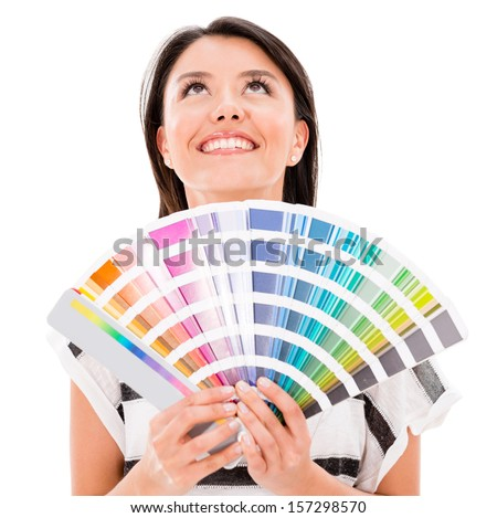 Thoughtful woman holding a color guide - isolated over a white background