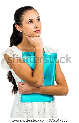 Thoughtful woman holding plastic folder with fist on chin on white screen - stock photo